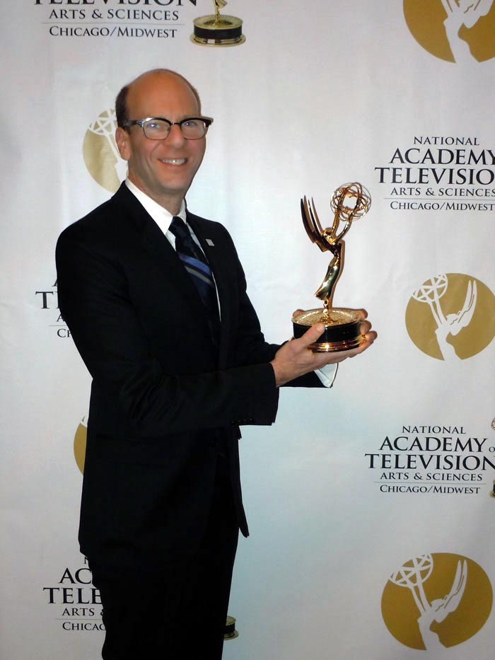 Aldo Leopold Foundation board member Rett Nelson accepts the Emmy ® award