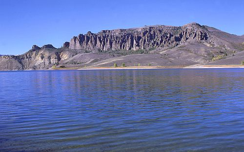 Image of surface water of reservoir with backdrop of pinnacles