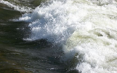 Image of wave at a river rapid