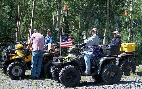 Image of a group of people on ATV's
