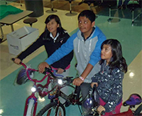 The Skagit-Mount Vernon Kiwanis Club awarded bikes to Isabel Cruz (12), Maycol Ibanez (13), and Daniella Becerra (10) from Mt. Vernon, Wash. Story by Kathy Vue.