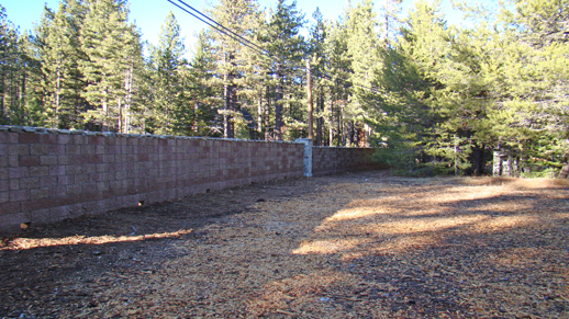 Color photo of the new barrier wall at the campground at Meeks Bay Resort.