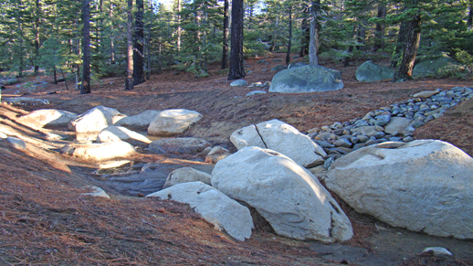 Color photo of the new large infiltration basin at Meeks Bay Campground.