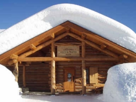 The Lolo Pass Visitor center covered in snow