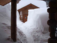 The warming hut at the Lolo Pass Vistor Center covered in snow is warm and inviting during winter.