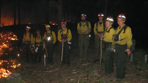 Photo: Forestry Technicians (Fire) finishing up a prescribed burn at night.