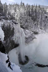 Salt Creek Falls in winter with icy falls and snow all around