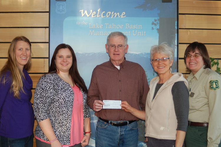 Joe Tillson, President of the Tahoe Heritage Foundation, receives a donation of $2,300.