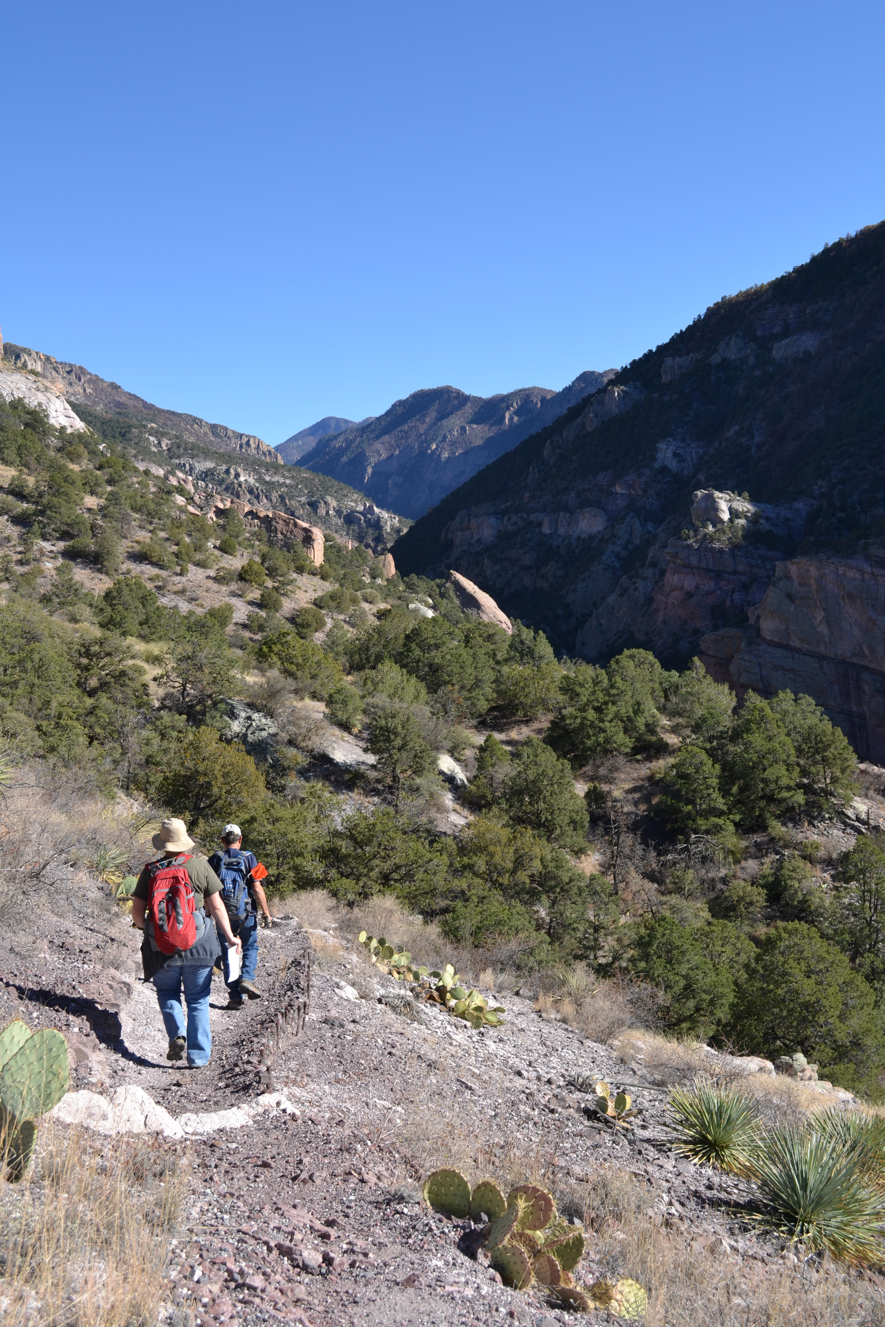 Hikers traverse the hillside trail above Whitewater Canyon.