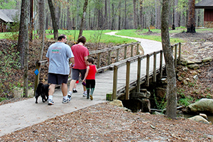 Family walking at Boykin Springs Recreation Area on the Angelina N.F.