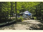 Tent and canoe at a White Mountain National Forest campground.