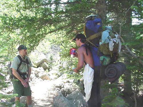 Forest Protection Officer (FPO) talking with a backpacker