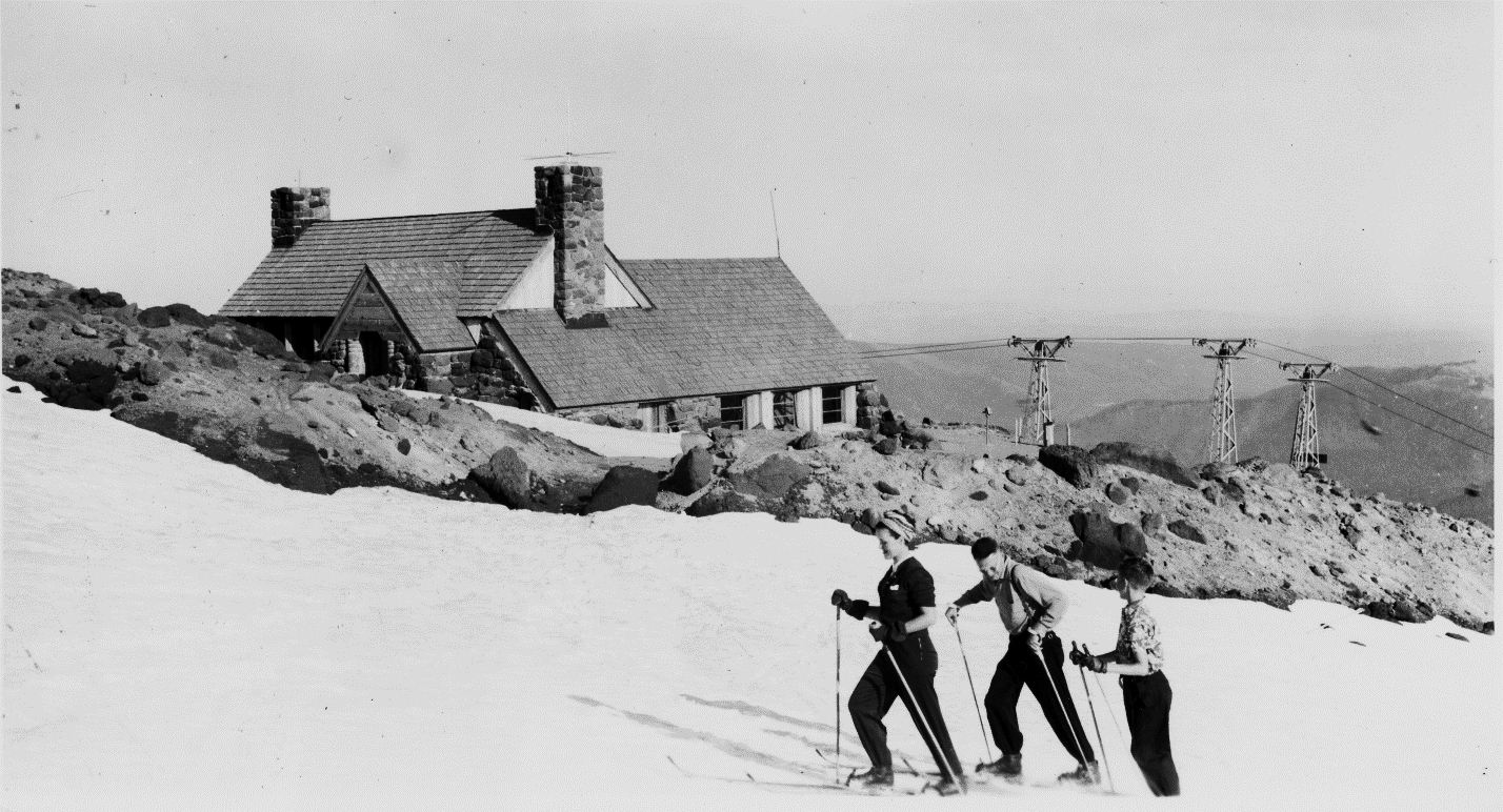 Slicox Hut with skiers in the foreground