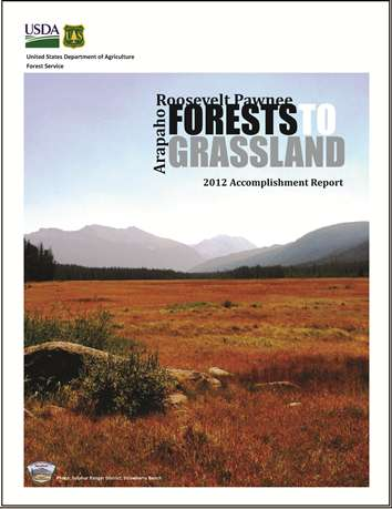 image of the report cover including a fall colored grassland with a mountain range