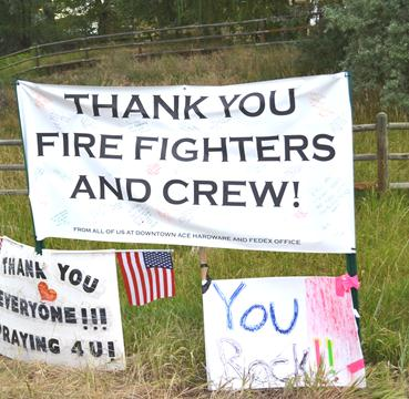 Thank you firefighter signs line the road
