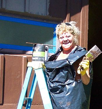 photo of woman with paintbrush
