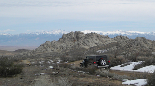 Jeep and mountain panorama, view from Buttermilk Road
