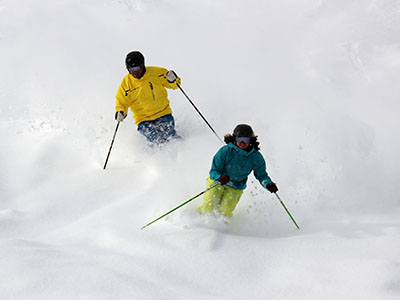Two skiers enjoying the fresh powder at Lookout Pass