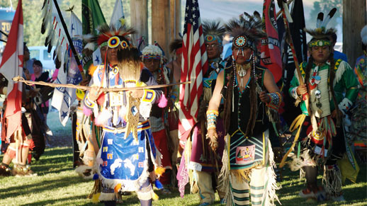 Nez Perce dancers in traditional regailia at the Tamkaliks celebration