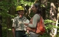 Two managers discuss a watershed restoration project