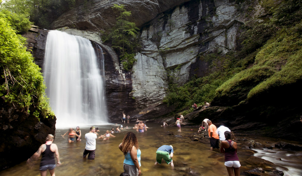 People play in Looking Glass Waterfall, Pisgah National Forest, North Carolina. USDA Forest Service photo by Cecilio Ricardo.