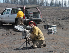 A researcher checks equipment after the June 20, 2019 prescribed fire in the Fishlake National Forest.