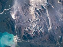 Remote sensing image that shows the locations of photo essay images (numbered), Chaitén Volcano (CV) and town (CT), and Minchinmávida volcano (M) with its extensive ice cap.