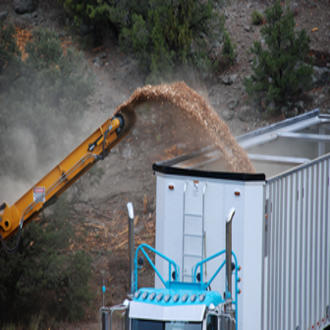 A truck is filled with wood chips that will be used to generate electricity. USDA photo.