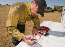 Fire Effects Monitor Dustin Smith taking field weather observations.
