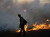 A firefighter uses a drip torch to start a prescribed fire.