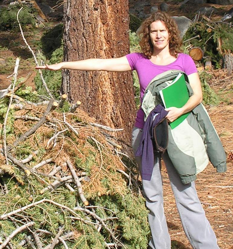 Angela White next to a burn pile