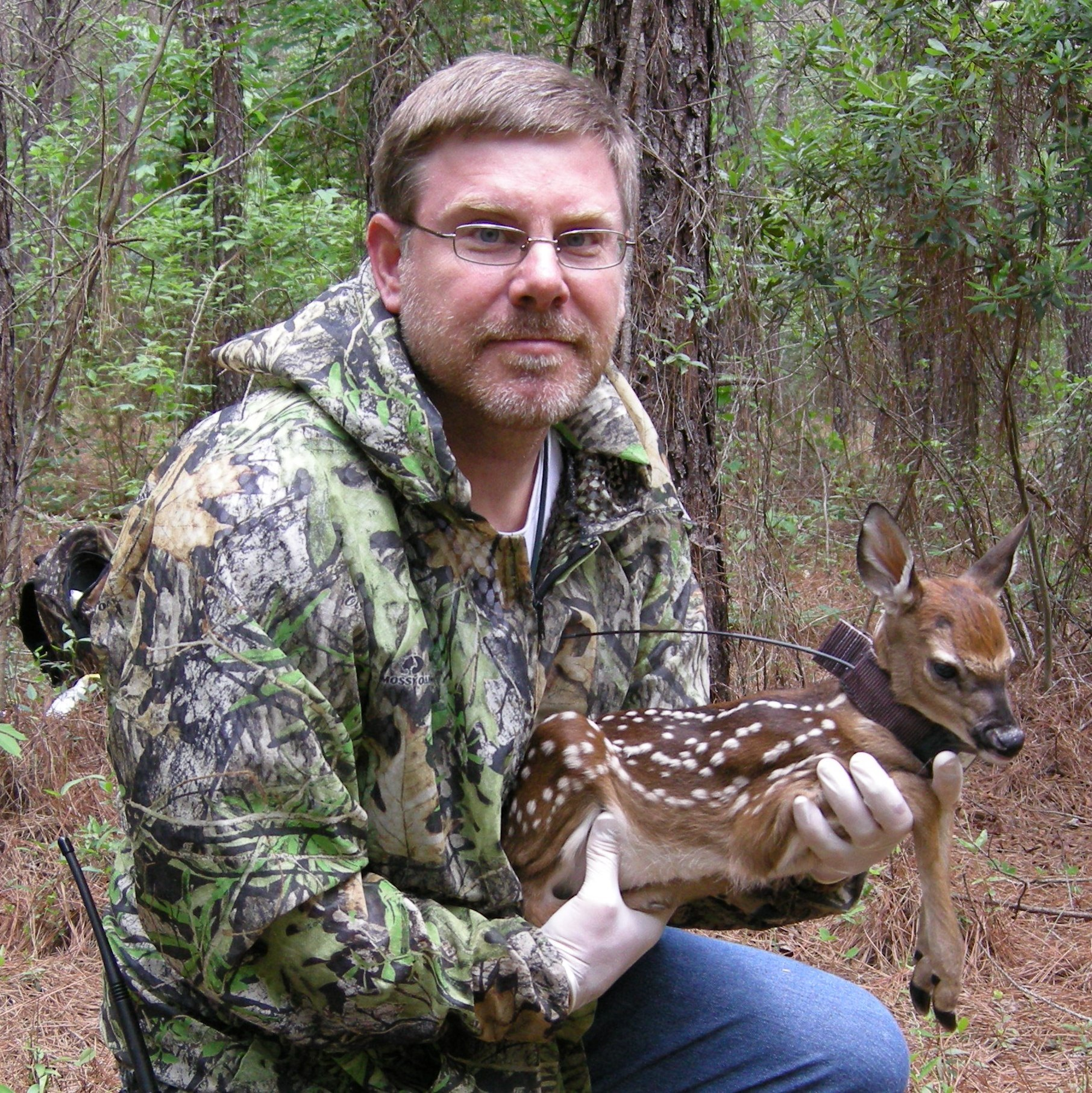 John Kilgo with radio-collared fawn