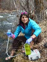 Kellie Carim collecting an eDNA sample