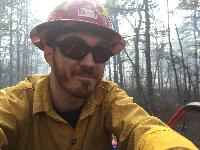 Mike Gallagher using a GPS to monitor the progression of a prescribed fire ignition line in the New Jersey Pinelands