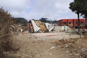 Photo of Tsunami damaged building in the town of Dichato, Chile, 2010. Forest Service