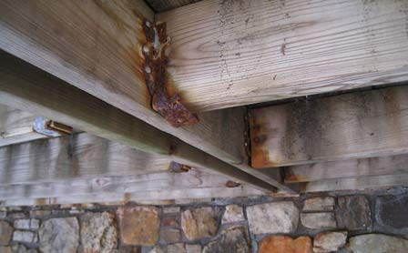 Photo of Serious wood/metal corrosion of a fastener under a deck in Branson, MO. Samuel L. Zelinka, Forest Service