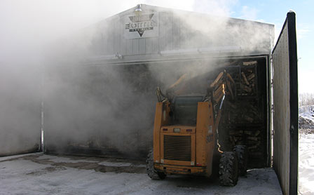 Photo of Commercial dry kiln is used to heat treat freshly cut hardwood firewood for interstate commerce. Forest Service