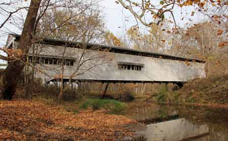 Photo of The Portland Mills Covered Bridge in Parke County, Indiana, has a Burr-Archtruss design. James Wacker, Forest Service