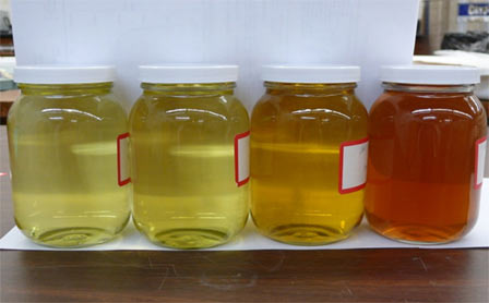 Photo of Aqueous extract solutions under different pretreatments. Steve Schmieding, Forest Service