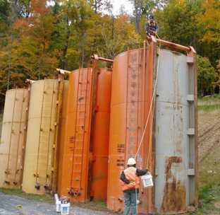 Photo of Sampling tank-stored fracing fluids. Pam Edwards, Forest Service
