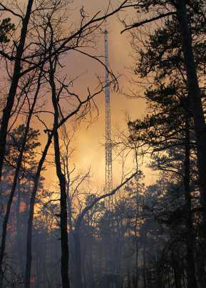 Photo of Instrumented towers set up within and in the vicinity of prescribed fires in the New Jersey Pine Barrens provide critical meteorological and air quality data for validating smoke prediction tools.  Nicholas Skowronski, Forest Service