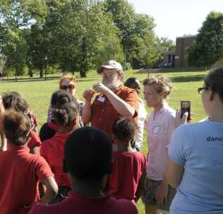 Photo of Dr. Mark Twery of the NRS describing the structure of a dandelion stem to participants in the Moving Field Guide workshop at Patterson Park in Baltimore. Steward Pickett, Baltimore Ecosystem Study LTER, Cary Institute of Ecosystem Studies