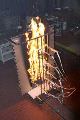 Photo of Lab experiment showing flame wall apparatus, sensor placement and close-up of turbulent eddies intersecting the heat flux sensor and thermocouple arrays. Forest Service