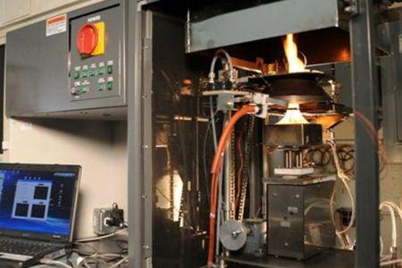 Photo of Cone calorimeter testing simulates realistic fire scenarios. Steve Schmieding, Forest Service