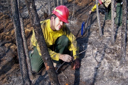 Photo of Field crew measure the amount of remaining fuel on the forest floor after a prescribed burn on Nenana Ridge, Alaska. Roger Ottmar, Forest Service