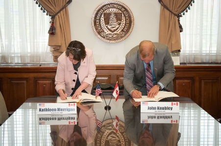 Photo of USDA Agriculture Deputy Secretary, Dr. Kathleen Merrigan (left) and John Knubely (right), Deputy Minister, Canada Agriculture and Agri-Food sign a Memorandum of Understanding verifying enhanced collaboration in Agroforestry between the two nations at the United States Department of Agriculture, April 17, 2012 in Washington, DC. Bob Nichols, USDA