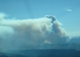 Photo of Plume of the Big Salmon Lake Fire on August 17, 2011: one of 25 fires studied in the Smoke Emission and Dispersion field project. Forest Service