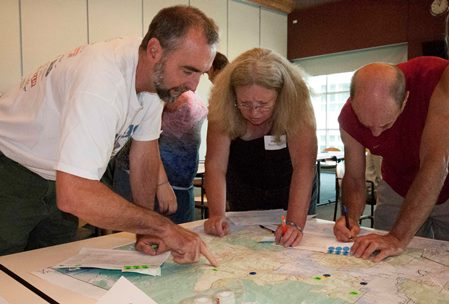 Photo of Workshop participants map priority areas as part of the Human Ecology Mapping Project. Renee Bodine, USDA Forest Service