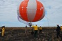 Photo of Researchers prepare to launch a balloon into a smoke plume to measure emissions during an operational scale fires at Eglin Air Force Base, Florida. Roger Ottmar, USDA Forest Service