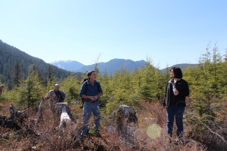 Photo of During a field tour of Heen Latinee Experimental Forest, Alaska, attendees learned about ongoing research on yellow-cedar. Judy Mason, USDA Forest Serivce